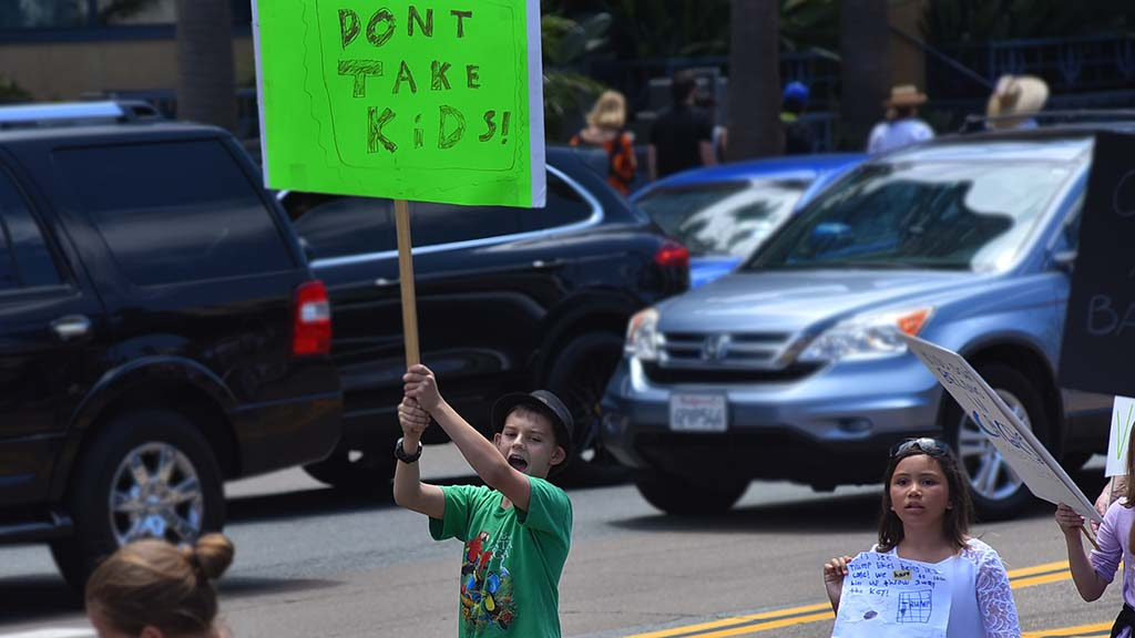 Children protested alongside their family members in downtown San Diego.