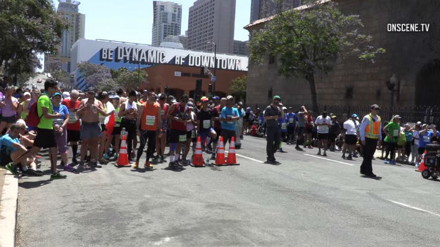 Runners wait during incident