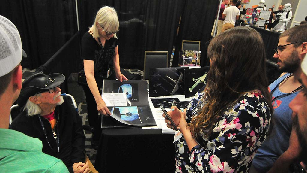 Sierra Doll, partner of film artist Colin Cantwell shows photos of his work including Star Wars designs at InterGalactiCon.