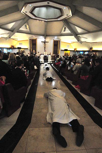 The four men to the ordained prostrate themselves as a sign of humility during the ceremony.