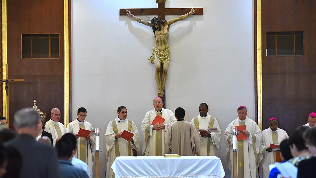 Four men were ordained Jesuit priests during the more than two-hour ceremony.