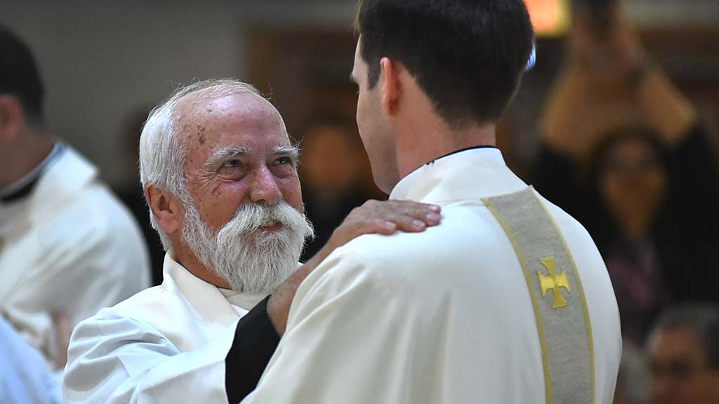 A Jesuit priest welcomes Thomas Flowers into the priesthood.