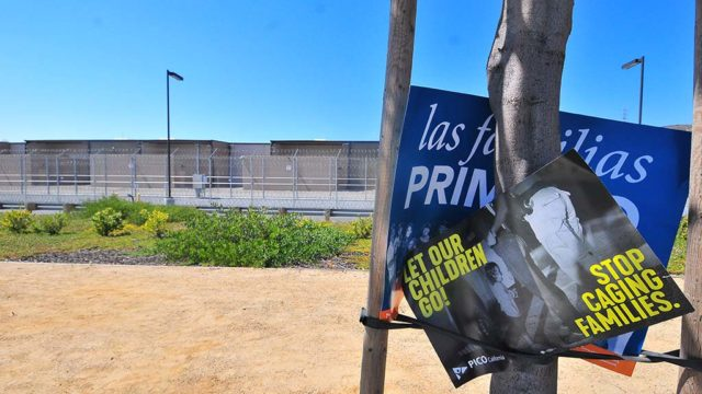 Protest signs were left outside the Otay Mesa Detention Center.