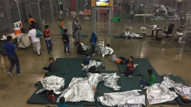 Separated immigrant children sleeping on floor
