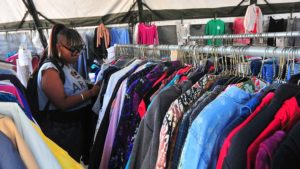 Talai Robb, who served in the Army, picks out clothing for herself and two children at Stand Down.