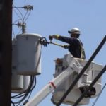 Electrician working on transformer