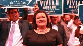 With San Diego Councilman David Alvarez (left) cheering her on, District 8 candidate Vivian Moreno makes a triumphant entrance at Golden Hall.
