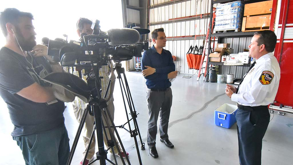 County Fire Authority (and San Diego Cal Fire) Chief Tony Mecham chats with TV crew after news conference.