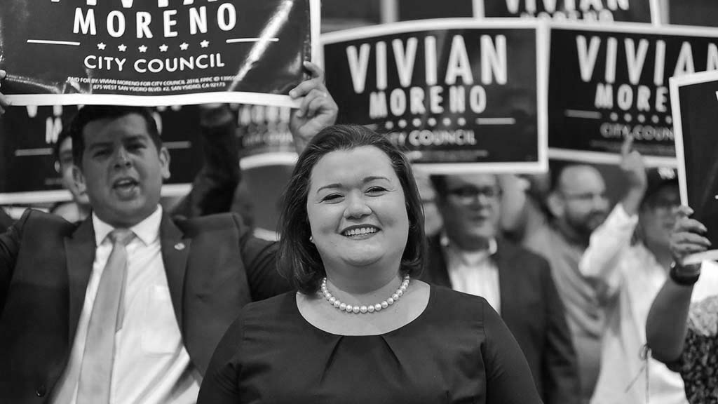 With San Diego Councilman David Alvarez (left) cheering her on, District 8 candidate Vivian Moreno makes a triumphant entrance at Golden Hall.