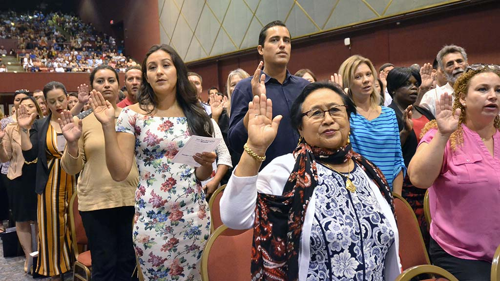 More than 1,000 Immigrants from 75 countries took an oath to pledge allegiance to the U.S. and become citizens.