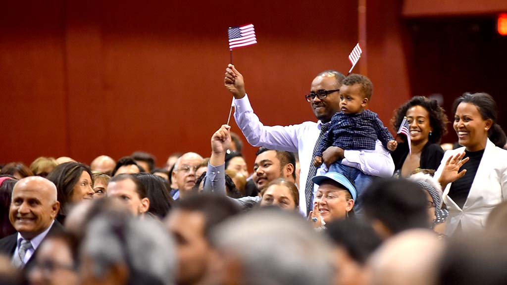 A family from Egypt stood as the judge called their country's name at the beginning of the ceremony.