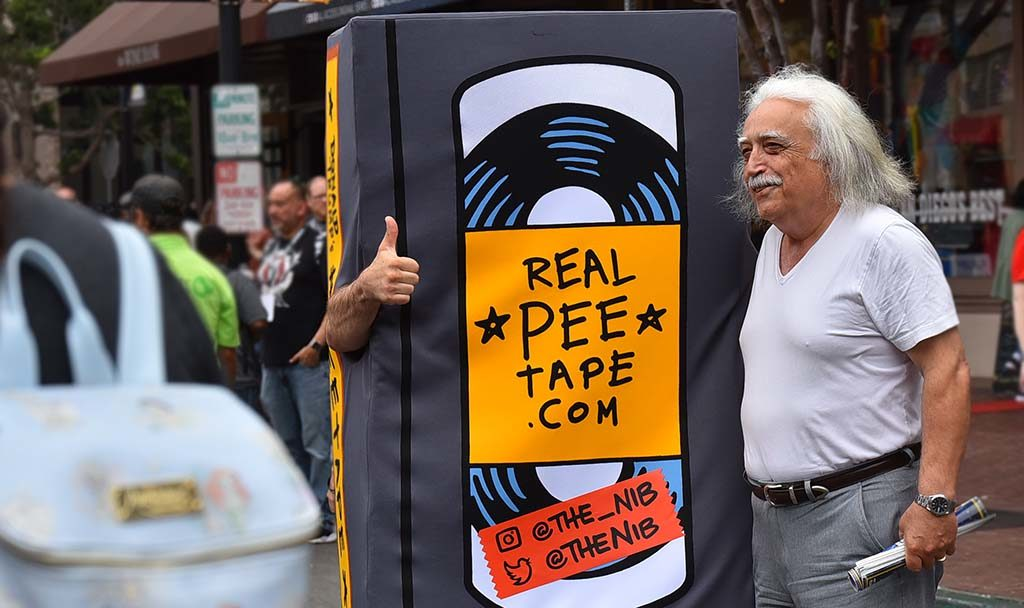 A man poses with a Pee Tape on Fifth Avenue near Comic-Con.