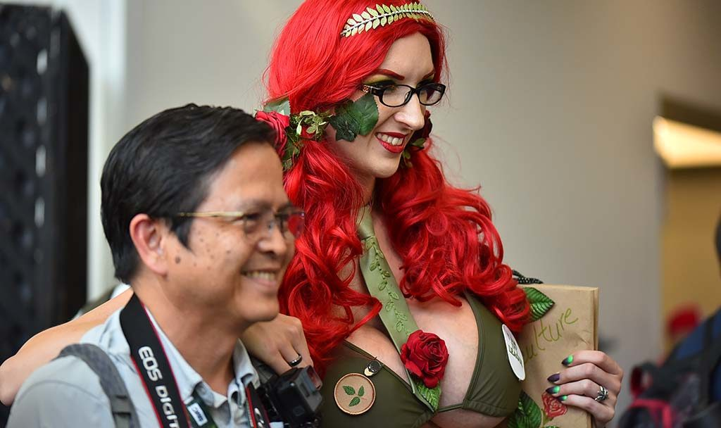 Fae Black of San Diego as Poison Ivy poses with a happy admirer.