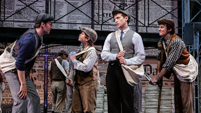 "Cast members in ""Newsies"""