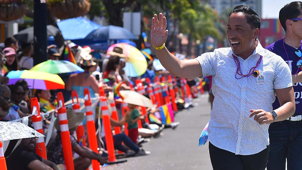 State Assemblyman Todd Gloria waves to the crowds along the parade route.