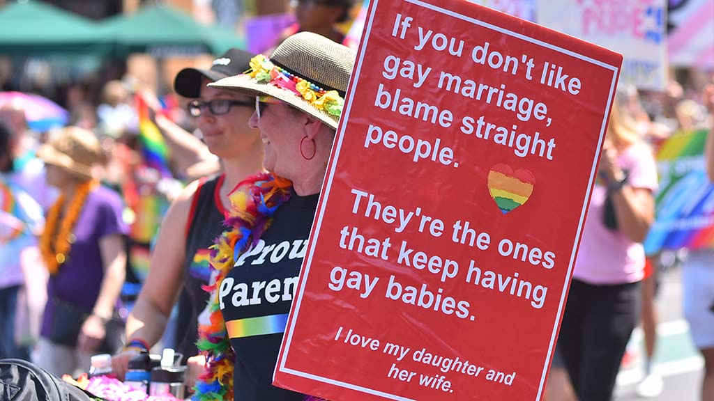 Proud parents show support for their children in the San Diego Pride Parade.