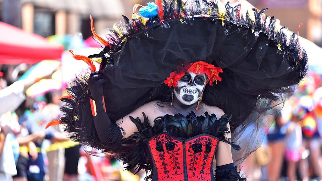 Members of a Hispanic group dress in Dia de Los Muertes costumes.
