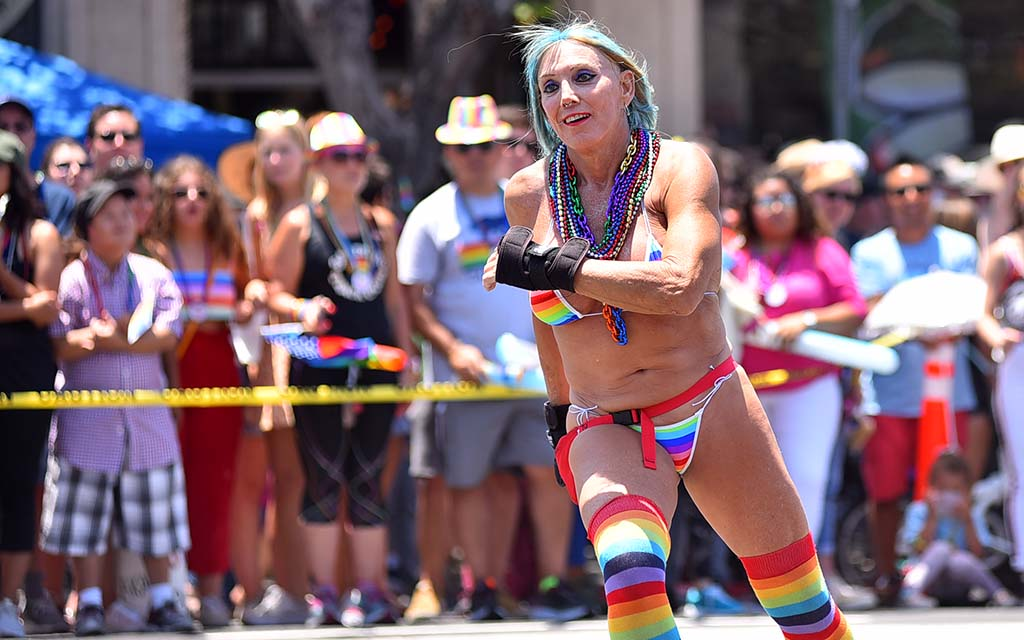 A roller skating San Diego Pride Parade participant entertains the crowds.