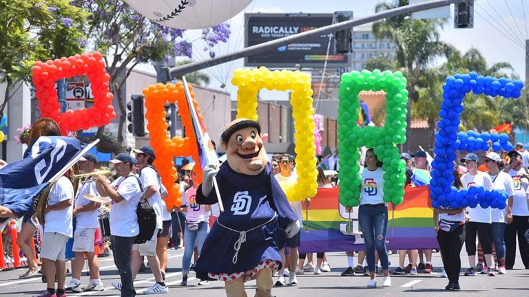 The San Diego Padres Friar leads Padre supporters of the Pride Parade.