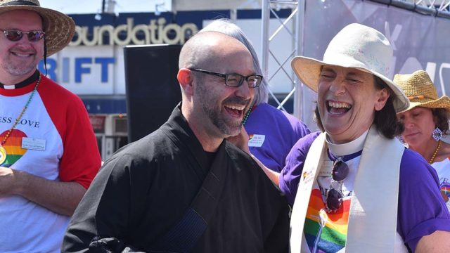 Religious community leaders share a laugh before the beginning of the San Diego Pride Parade.