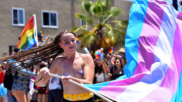 A flag-waving participant entertains the crowd.