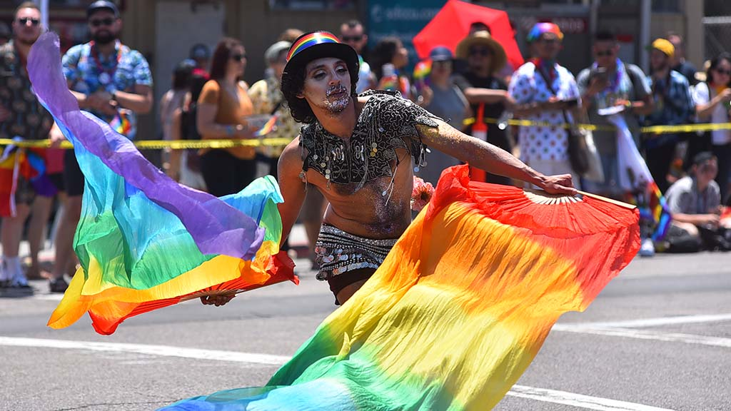 A performer in the Pride Parade entertains the crowds along the parade route in Hillcrest.