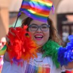 A parade participant from the Marriott Hotel shows her colorful best.