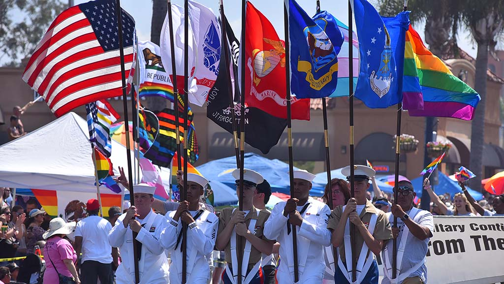 Military members of the Army, Navy and Marines participate in the San Diego Pride Parade.
