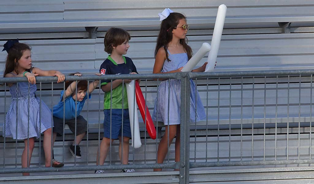 Children with Thundersticks follow the action at the University of San Diego.