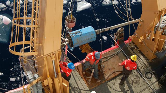 Researchers gathering sediments