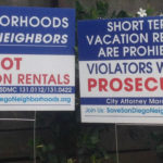 Signs protesting short-term rentals