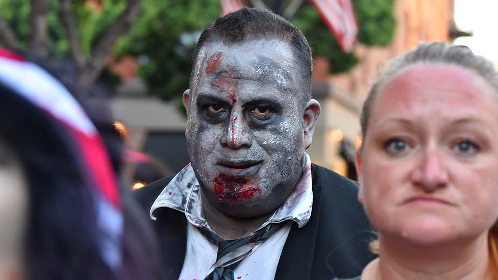 """A well-dressed zombie was one of the """"horde"""" leaders in the Gaslamp Quarter."""