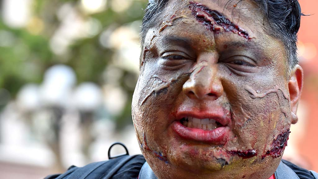Zombies took as much care with makeup as cosplayers inside the San Diego Convention Center.