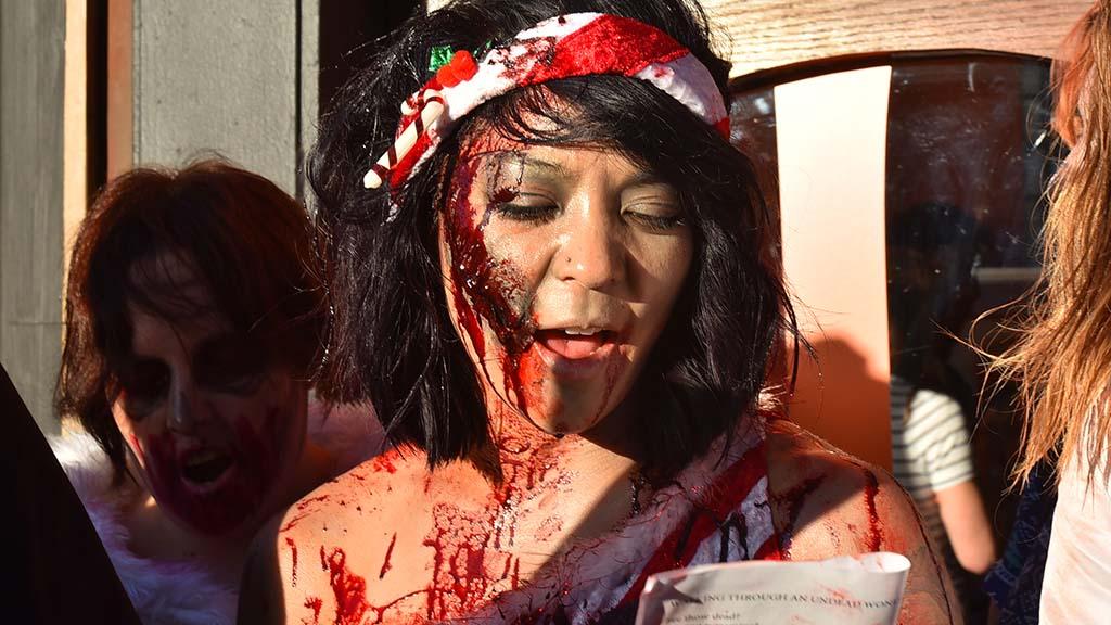 Zombies sometimes held lyrics to carols written by Jennifer Muzquiz of Long Beach.