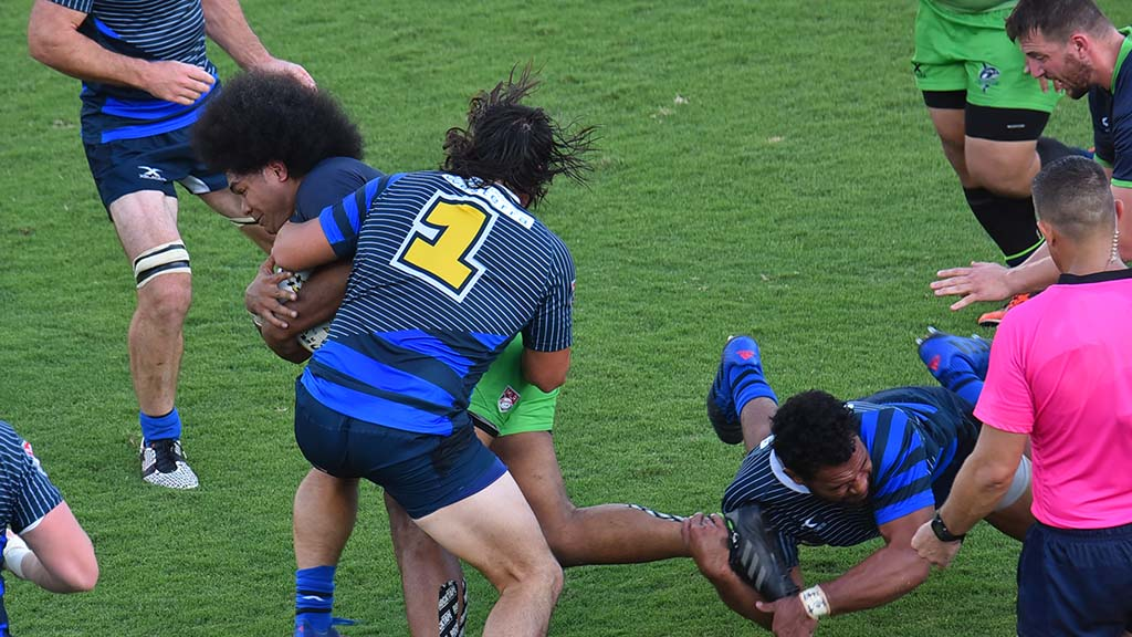 Glendale Raptors get a grip on a Seattle ballcarrier.