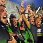 Holding silver plaque, Seattle Seawolves celebrate Major League Rugby title at Torero Stadium.