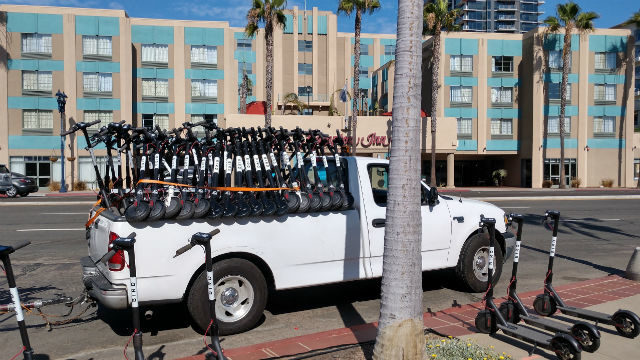 Bird electric scooters being delivered