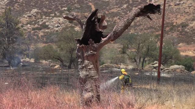 Firefighter douses hot spot