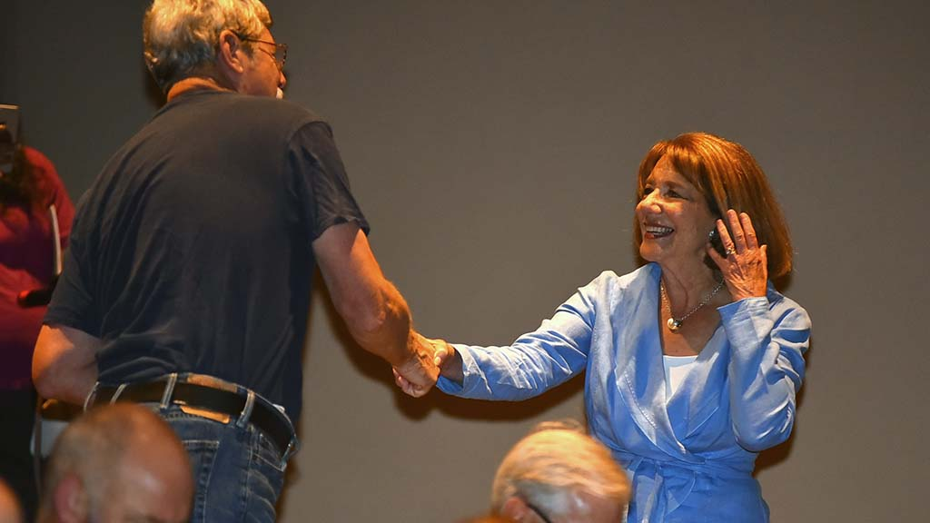 U.S. Rep. Susan Davis greets attendees at a town hall meeting at Southwestern College.