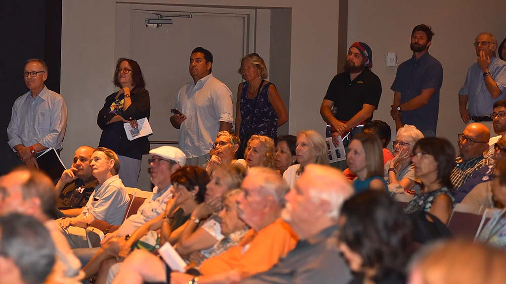 Audience members line up to ask questions of U.S. Rep. Susan Davis at a town hall meeting.