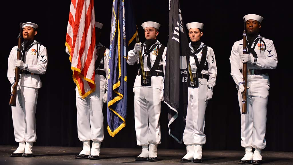 A Navy color guard unit participated at the beginning of a town hall meeting with U.S. Rep. Susan Davis.
