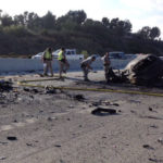 CHP officers examine wreckage