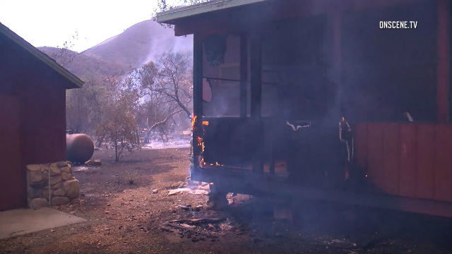 Building burns in Holy Jim Canyon