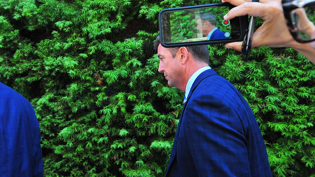 Rep. Duncan Hunter says nothing as he leaves the federal courtroom after his arraignment.