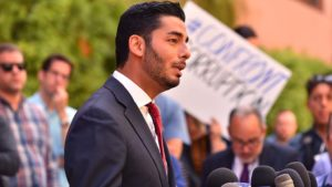 Ammar Campa-Najjar, Democratic candidate for the 50th congressional district, speaks to the media and protesters outside the federal courthouse.
