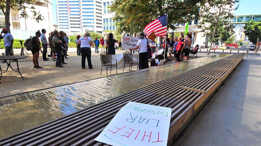 Protesters organize themselves outside of the federal courthouse for the arraignment of Rep. Duncan D. Hunter.