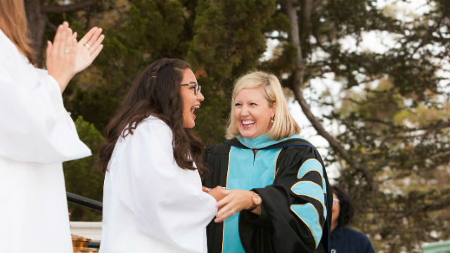 Dr. Lauren Lek congratulates a student