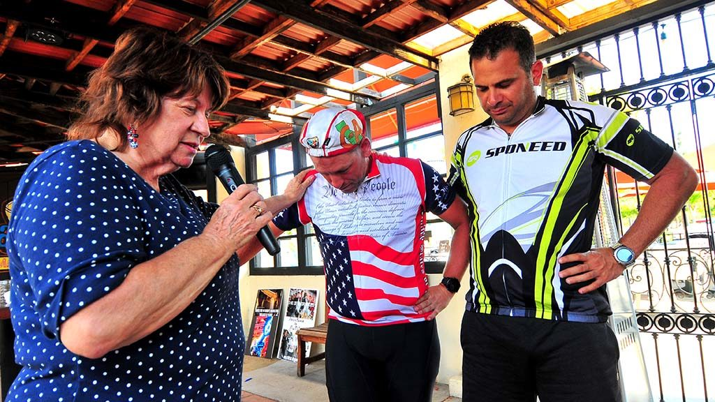 66561d556bf Lenna Carpentier prays for the safety of the two candidates who bike to  their events. Photo by Chris Stone