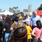 Mayor Kevin Faulconer hands out backpacks