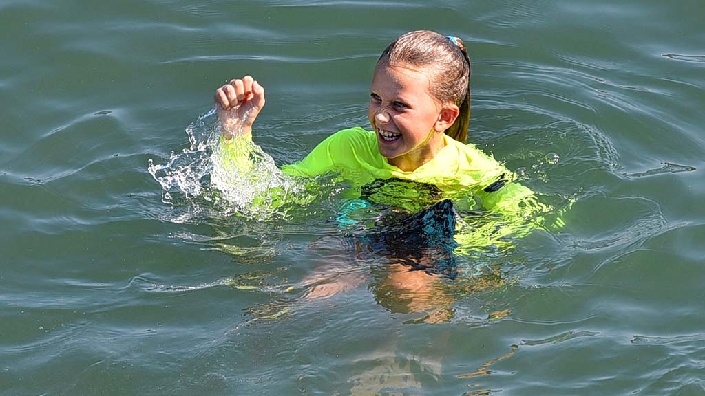 A junior lifeguard showed her pride in a successful jump at Ocean Beach.